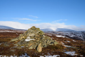 Cairn with Braid Cairn behind, Angus, Scotland
